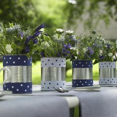 Tin can centerpieces for a cute outdoor tablescape!  Add red flowers!