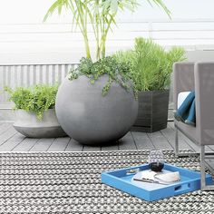 Shop Ball Planters.  Earth-friendly globe planter does a world of good, cast of naturally derived mineral compounds, sea salt, sand and fiber and manufactured with low emissions and minimal energy use.
