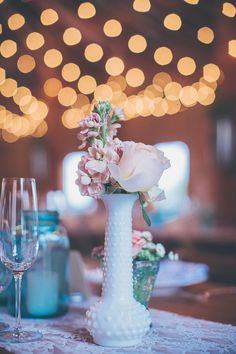 milk glass centerpieces, photo by Kris Holland http://ruffledblog.com/sacramento-barn-wedding #wedding #reception #vases