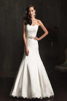 Wedding Dress  Neckline: Strapless Sleeve: Sleeveless Hem: Floor length Train: Chapel Length Silhouette: A-line Fabric:  Lace Satin