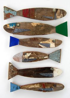 Kooky fish made out of reclaimed wood and recycled finds - playful wall art for a coastal home!