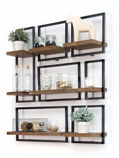 SHELFMATE, in short: a piece of premium teak that floats. in a stylish, black iron frame. The combination of wood and iron is the signature of d-Bodhi. , SHELFMATE in short: A piece of premium teak wood that 'floats' in… Continue Reading → Manly Living Room, Home And Living, Living Room Decor, Wood Living Rooms, Modern Living, Ikea Interior, Interior Design, Interior Ideas, Handmade Home Decor