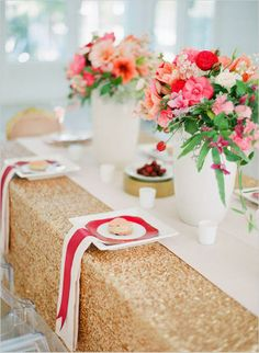 a gold sequin tablecloth, striped napkins, a printed plate and bright red and pink florals for centerpieces - Weddingomania Reception Decorations, Event Decor, Wedding Centerpieces, Table Centerpieces, Centerpiece Ideas, Wedding Receptions, Wedding Tables, Reception Ideas, Table Decorations