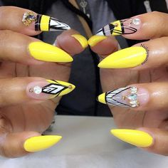 Stiletto yellow and black gorg nails