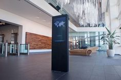 juniper lobby - In the lobby of Juniper's new executive briefing center is a hanging light display that acts as an interactive map of the world