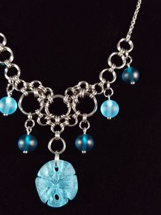 Gorgeous Frosted Sea Glass Chainmaille necklace in Aquamarine and Teal made by the Gipsy Fire Jewelry Co. Bring the beach to you with this ocean inspired piece!