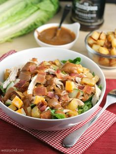 Loaded BBQ Chicken Salad: Crisp lettuce smothered with chicken, bacon, cheese, and roasted potatoes is drizzled with a BBQ salad dressing!