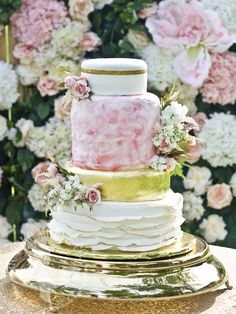 Gold leaf and watercolor floral wedding cake.