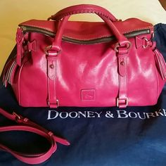 "Dooney & Bourke Florentine Satchel in Fuschia  Thinking about selling this beauty to buy something else. This is the largest size 15"". This is one of the original bags with leather key keeper. Gorgeous and gently used. Minor corner rub. Comes with long strap and dust bag. Dooney & Bourke Bags Satchels"