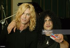 Guitarist Slash (R) and bassist Duff McKagan of Velvet Revolver record the charity cover of Eric Clapton's 'Tears In Heaven' Tsunami Relief Single at Whitfield Studios on January 20, 2005 in London. Other stars to contribute to the single will include Robbie Williams, Rod Stewart, Pink, Ozzy and Kelly Osbourne, Andrea Bocelli, Gwen Stefani, Gavin Rossdale, Robert Downey Jr., Phil Collins, Josh Groban and Aerosmith's Steve Tyler. The single is an initiative of Sharon Osbourne, and proceeds…