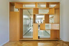 Paddington Terrace Timber element forms joinery/kitchen/entrance/shelving - key element. Unified. Bridges spaces, controls light, creates interest.