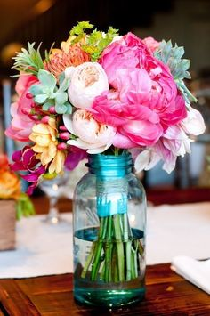 flowers in mason jars cute for a southern wedding. Carry the flowers in mason jars instead of a bouquet Deco Floral, Floral Design, Textile Design, Graphic Design, Blue Mason Jars, Flower Power, Floral Arrangements, Mason Jar Flower Arrangements, Summer Flower Arrangements