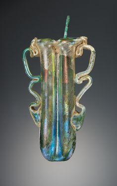 Bipartite Kohl Tube; Unknown; Roman Empire; 3rd - 4th century; Glass, bronze; 11.5 x 7 cm (4 1/2 x 2 3/4 in.); 2003.431; J. Paul Getty Museum, Los Angeles, California