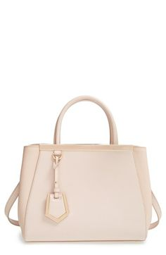 Free shipping and returns on Fendi 'Petit 2Jours Elite' Leather Shopper at Nordstrom.com. Subtle textural variation elevates a legendary leather shopper rescaled to ladylike proportions. A sleek logo top bar and a dangling enameled luggage tag provide a signature finish.