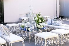 Take us back to this gorgeous setup! How can you beat all white with pops of blue and bird cages?! || VENUE: @at_the_p | FLORAL DESIGN: @shawnayamamoto | CATERING: @goodgraciousevents @paulineparry | BAR: @scarbarla | DESIGN DECOR: @rrivre_works | PHOTOGRAPHY: @brianleahyphoto | ENTERTAINMENT: @luxuryentertainmentgroup | CONSULTANT: @mindyweiss | PHOTOBOOTH: @sociallightsocal | AV: @pacificeventservices | MUA: @blushington | COFFEE: @thecappuccinoman | DANCING WAITSTAFF…