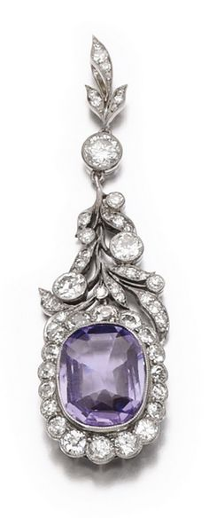 A. Tilander - An antique sapphire and diamond pendant, early 20th century. The cushion-shaped purple sapphire within a frame and suspension of foliate deisign set with circular-cut diamonds, signed A.Tilander.