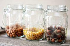 Using hanging mason jars and fillers, you can create fabulous fall decor in minutes! #masonjars #diy