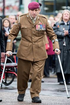 Ben Parkinson attends Remembrance Sunday in Doncaster wearing full Army uniform for the 1st time after receiving new prosthetic legs. Ben is now his full height with a pair of X3 Geniums prosthetic legs, which are taller than ones he had previously + have 'intelligent technology.' The former paratrooper was wounded when the vehicle in which he was travelling hit a mine in Helmand Province, Afghanistan, 2006. Ben suffered the loss of both legs, severe brain injuries + a broken spine in the…