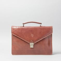The Lorenzo small leather briefcase for men. http://www.maxwellscottbags.com/products/lorenzo-slim-small-leather-briefcase.html