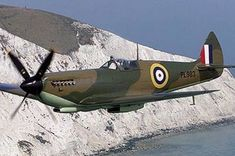"""a beautiful raf spitfire in flight,looks like english """"white cliffs of dover"""".Spitfire Mk VIII, possibly a film star, seeing as its in an early war colour scheme that it would not have worn in service. Aircraft Photos, Ww2 Aircraft, Fighter Aircraft, Military Aircraft, Fighter Jets, Battle Of Britain Movie, Spitfire Supermarine, The Spitfires, Ww2 Planes"""
