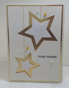 Stampin' Up! ... handmade Christmas card from magpiecreates ... white and gold ... great use of embedded die cut technique ...stars die cut in shiny metallic gold and filled with white glimmer paper ... suspended on gold gel pen lines ... a few pearls strewn about ... elegant look ... luv it!@