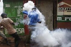 As Kenya goes to the polls again, a supporter of the opposition coalition the National Super Alliance and its presidential candidate Raila Odinga, is covered in police tear gas during a protest in Kibera slum, Nairobi.  . Week in pictures: 22-28 October 2017 - BBC News