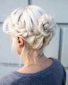 Laced braid updo into knotted bun by Marc Daniels