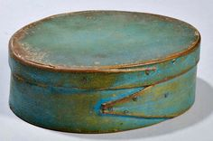 Skinner's - The Personal Collection of Lewis Scranton, Auction 2897M. May 21, 2016. Lot: 180.  Estimate: $400-600.  Realized: $550.   Description:  Blue-painted Pantry Box, America, 19th century, oval, with fingered seam, ht. 2, lg. 6 in.   Provenance: Hollis Brodrick, 1983.