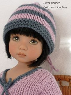 "She is wearing ""Hiver poudré"" one of my knitted creations. Outfit includes sweater, skirt, jacket and cap. Cotton and bamboo yarns from light pink to dark grey Créations Soudane"