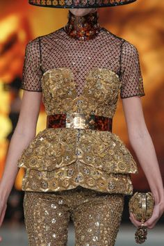 Finishing Aesthetic - Alexander McQueen is very well known for heavy embellishments, this garment shows the covering of a garment in beads and details to change the look and texture of the surface. This gives an amazing aesthetic to the garment, Alexander McQueen is always adding more and more to his designs pushing the boundaries of embellishment.  http://www.alexandermcqueen.com/gb/alexandermcqueen