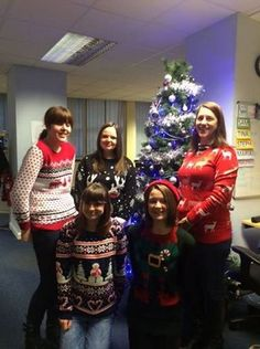 The Social Care team wearing their Christmas jumpers in aid of Save the Children.  Grosvenor House, 14, Bennetts Hill, Birmingham, West Midlands, B2 5RS
