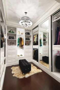 white walk-in closet with a mirror doors
