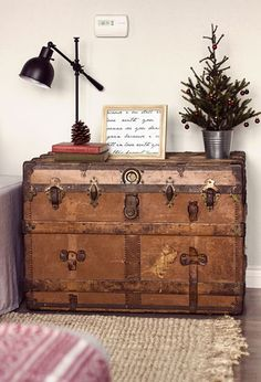 There's nothing wrong with repurposing vintage pieces, like this flea market trunk which serves as extra storage and a side table.