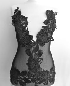 """With this dress I am using black """"skin fabric"""" and flower decorations. Skin fabric is difficult to work with because it´s so stretchy. Unique Dresses, Flower Decorations, Crop Tops, Fabric, Black, Fasteners, Tejido, Floral Decorations, Tela"""