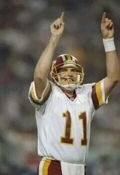 Super Bowl MVP Mark Rypien points to the crowd as the Redskins celebrate a 37 - 24 victory over the Buffalo Bills in Super Bowl XXVI.