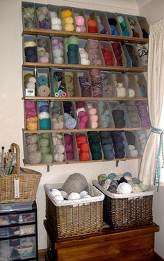 Magazine Bin Yarn Organizers.  I like my shelf of yarn, but this would help with keeping certain skeins from getting buried...  That being said.. I hope my stash stays somewhat small..