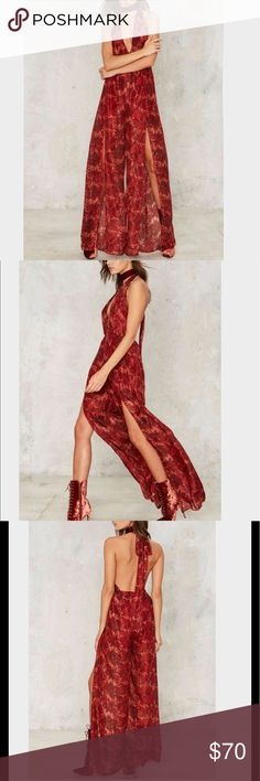 968🐰💛 Nasty Gal Silky Way Plunging Jumpsuit In a Nasty Galaxy far far away... The Silky Way Jumpsuit comes in red and features a plunging V-neckline, relaxed silhouette, and wide leg with thigh split detailing. Nasty Gal Pants Jumpsuits & Rompers