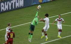 World Cup 2014: Germany goalkeeper Manuel Neuer is forced to palm away a shot on target from Ghana's Atsu