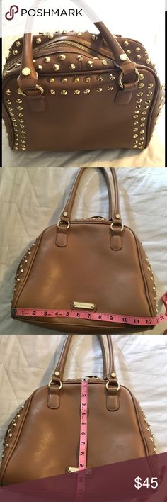 "Closet Clear Out Price Drop! 💵⬇️Steve Madden 👜Gorgeous Steve Madden gold studded bag!🔥 This bag is absolutely beautiful!  The sides and top are fill of gold studs, detailed gold ""Steve Madden"" branding on the handles and in the front!  Gold Zipper top, with interior pockets.  This purse is everything! Steve Madden Bags"