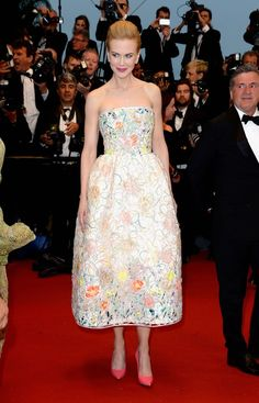 The Cannes Film Festival kicked off today, and if the celebrity red carpet gowns we've seen on day one are any indication we're in for a festival of fantastic, OMG-worthy gowns. Now this is how you do major glitz and glam, ladies. Carey Mulligan, star of that tiny little film you may have heard of (The Great Gastby, duh), chose a blush satin Dior couture gown for the film's premiere. It's a little reminiscent of a gown Gwyneth Paltrow has worn in the past but beautiful none th...