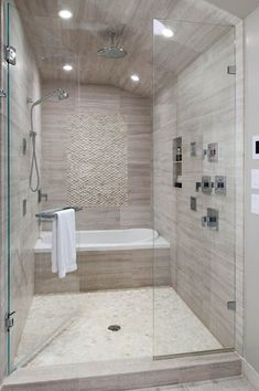 Contemporary Master Bathroom with Master bathroom, specialty tile floors, frameless showerdoor, Handheld showerhead