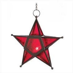 "Star light, star bright; this lantern is a witchie way to beautify candlelight! Patterned glass panels glow richly when lit from within, creating a captivating crimson glow. Invoke the fire within with this unique pentagram candle lantern! Weight 0.8 lb. Candle not included. Chain is 9 1/2"" long. Iron, Glass.    10 1/4"" x 3 1/2"" x 9 1/2"" high."