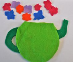 "Felt tea pots - ""sew"" with craft glue. Decorate with buttons, felt/cloth pieces, glitter glue"