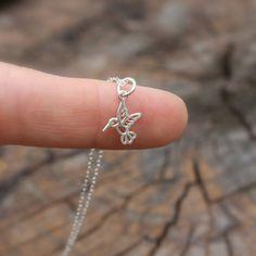 Hummingbird necklace - tiny sterling silver hummingbird . sterling silver chain . simple, modern charm jewelry. $26.00, via Etsy.