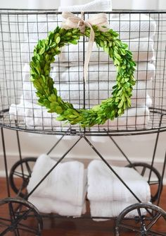 Vintage inspired metal laundry basket with wheels from Antique Farmhouse; so cute in the laundry room, bathroom, or even holding presents under the Christmas tree!