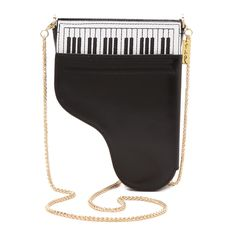 """A charming crossbody bag that hits all the right notes: a flap that opens like a piano lid, charming """"piano keys"""" and an elegant chain strap. - Leather.- Removable chain crossbody strap, 24"""" drop.- Top zip closure.- One outside flap compartment with mirror.- One inside open pocket.- One inside credit card slot.- Fully lined.- 5""""W X 7""""H X 1""""D. Please allow 2-3 weeks for delivery."""