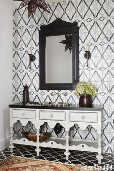 Sometimes two tiles are better than one. The radiating patterns in this worldly space also echo a vintage pendant and starburst-shaped sink.