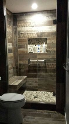 Kennewick, WA  Bathroom Remodel Custom walk-in shower with wood plank look tile walls and natural stone floor. Warwick Design, LLC.