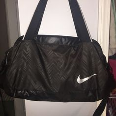 Nike gym bag. Cute subtle pattern. Cross body and tote straps. Can hold so much, two shoes, two outfits and a makeup bag. All zippers work perfectly. Used less than 5 months. Nike Bags Travel Bags