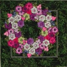 Wreath by Ans Schipper. I'm fairly sure that these are fussy cut regular hexagons that look like flower petals. Lovely.